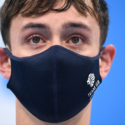 TOPSHOT - Tears well in the eyes of gold medallists Britain's Thomas Daley and Britain's Matty Lee (...