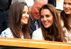 Kate and sister Pippa Middleton laugh in the Royal box in the Final at Wimbledon, 2012 (Photo by AMA...