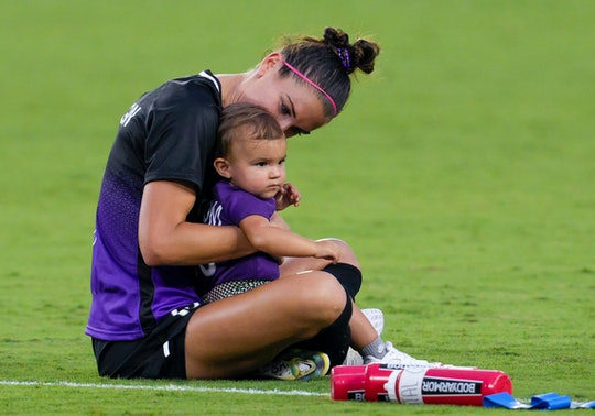 ORLANDO, FL - JUNE 20: Orlando Pride forward Alex Morgan (13) and her daughter Charlie after the NWS...