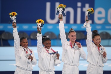 TOKYO, JAPAN - JULY 27:  The United States team with their silver medals on the podium, Jordan Chile...