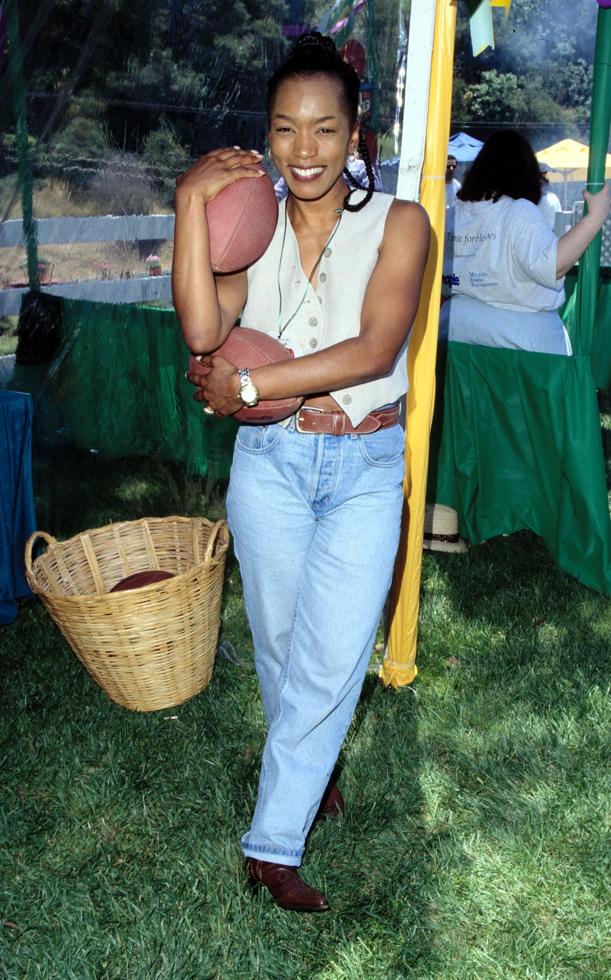 Angela Bassett in1996 wearing jeans