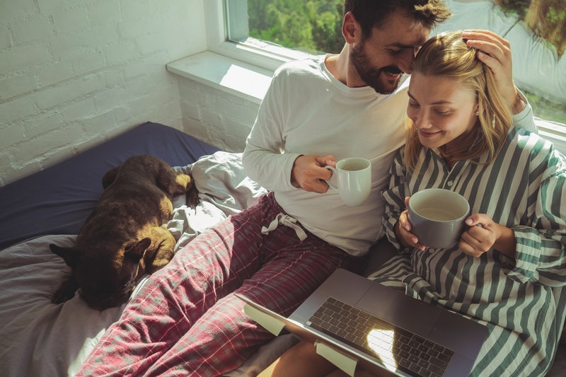 A couple drinks coffee in bed. Drinking coffee before sex can improve certain aspects of sex, an exp...