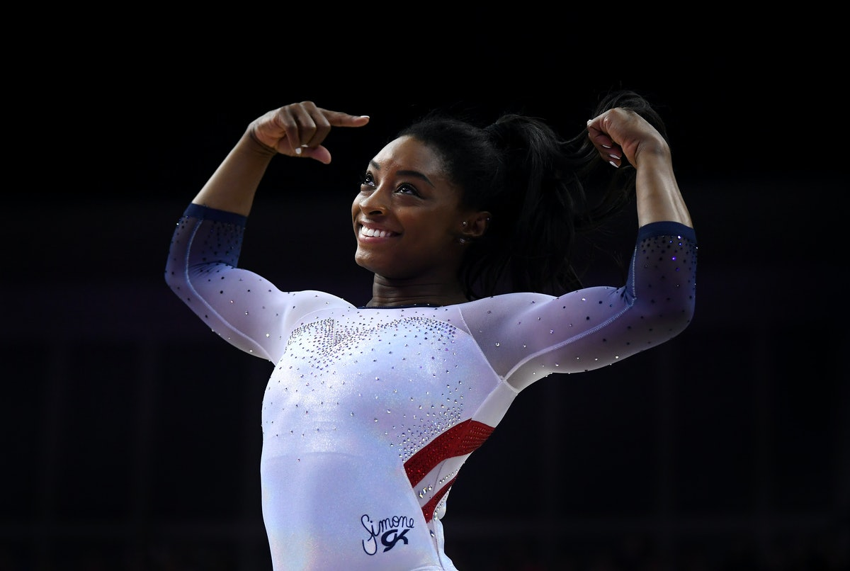 LONDON, ENGLAND - MARCH 23: Simone Biles of the USA reacts after finishing her her performance on ba...