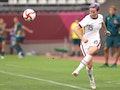 KASHIMA, JAPAN - JULY 27: Megan Rapinoe #15 of Team United States kicks the ball against Australia d...