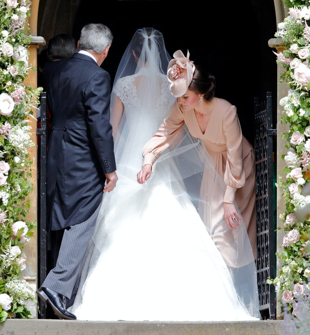 Kate Middleton helps her sister on her wedding day.