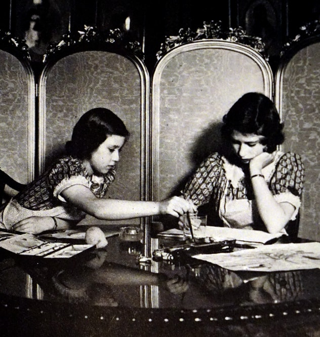 Queen Elizabeth and her sister Princess Margaret learning.