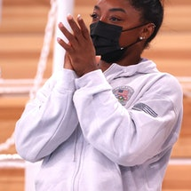 TOKYO, JAPAN - JULY 29: Simone Biles of Team United States applauds teammate Sunisa Lee after winnin...