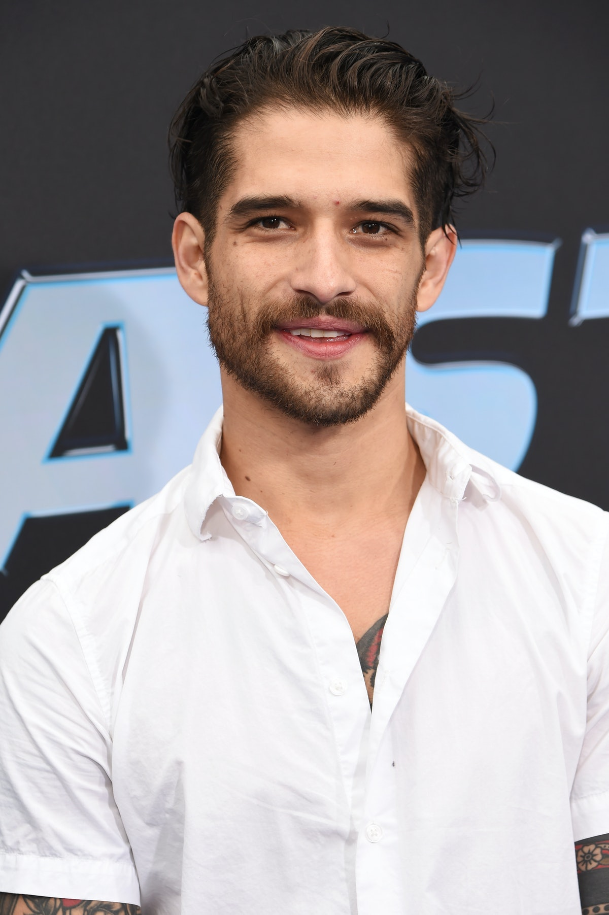 Tyler Posey opened up about how his girlfriend helped him realize he is LGBTQ+.