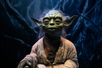 A life-size figurine of Yoda from the Star Wars series is displayed at the Star Wars Identities exhi...