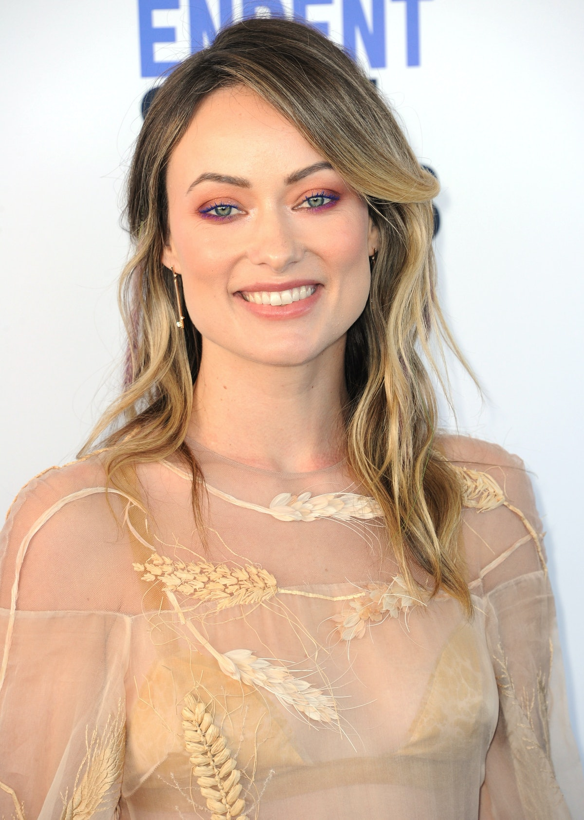 Olivia Wilde and Harry Styles were spotted kissing on a yacht in Italy.
