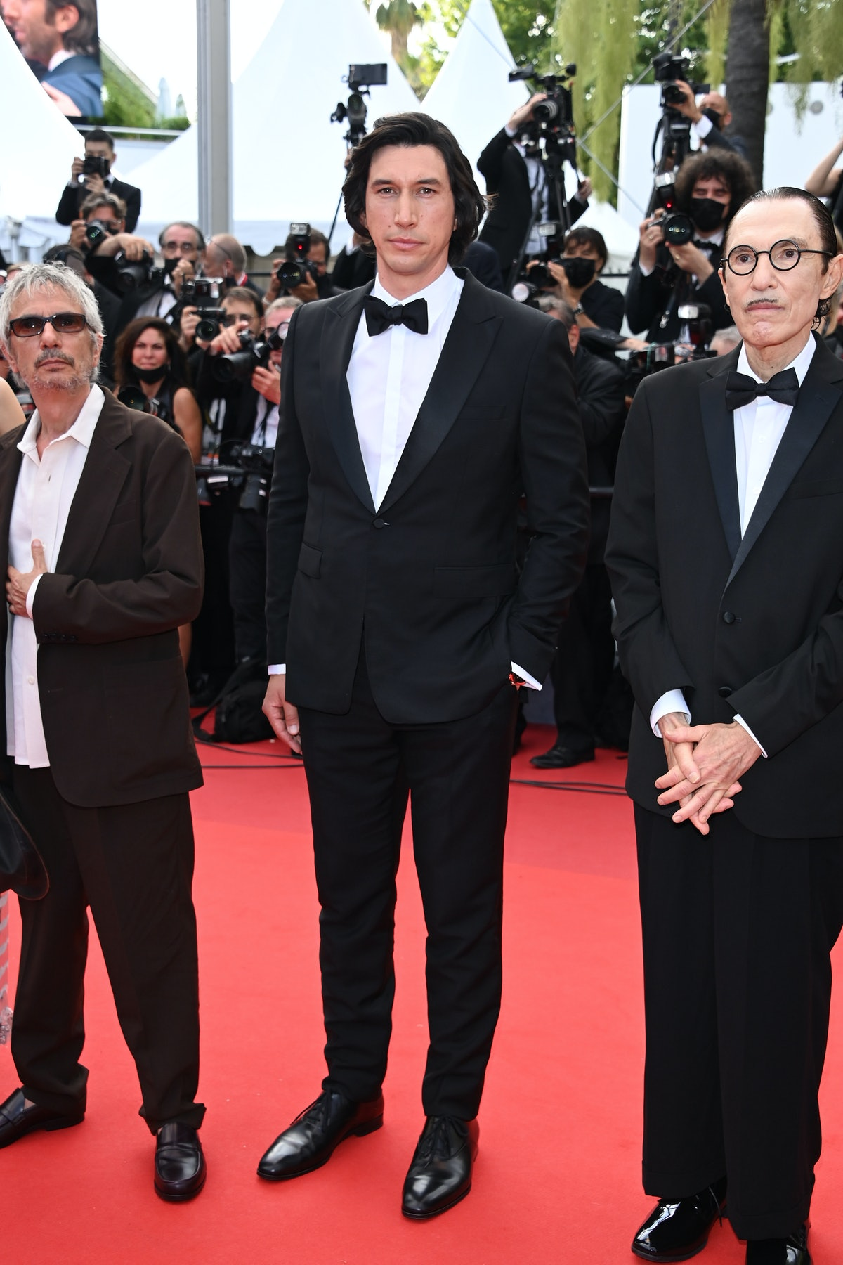 """CANNES, FRANCE - JULY 06: Adam Driver, Director Leos Carax and Ron Mael attend the """"Annette"""" screening and opening ceremony during the 74th annual Cannes Film Festival on July 06, 2021 in Cannes, France. (Photo by Daniele Venturelli/WireImage)"""