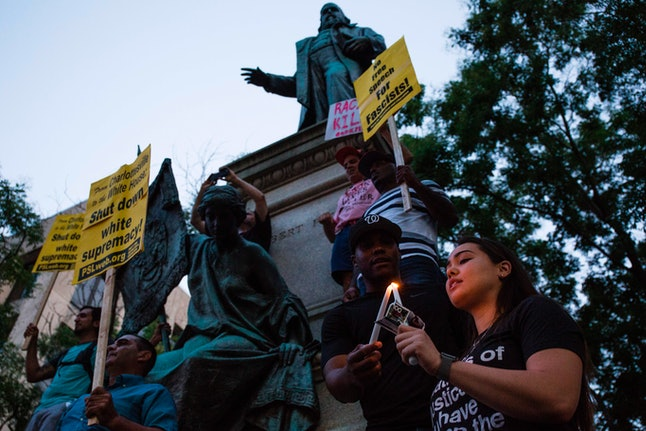 Demonstrators light candles in front of the statue of Confederate General Albert Pike on August 13, ...