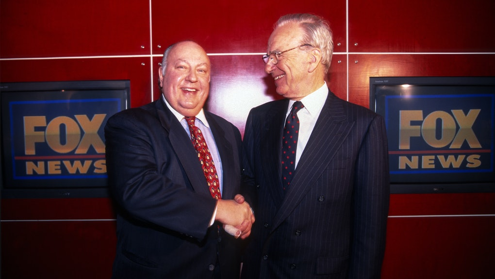 Rupert Murdoch shakes hands with Roger Ailes after naming Ailes the head of Fox News, New York, New ...