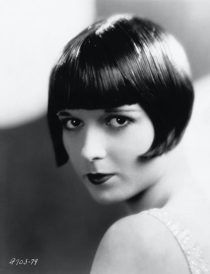 Louise Brooks donning the signature blunt bang and bob cut of the flapper era.