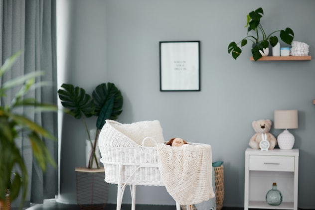 Still life shot of a crib in a nursery; white and gray color palette.