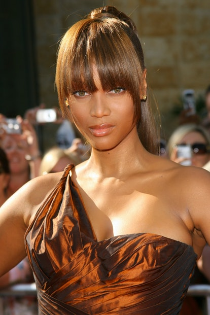 Tyra Banks in the blunt symmetrical bangs that were common in the 2000s.