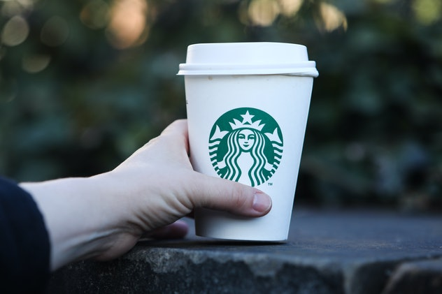 Starbucks Coffee logo is seen on disposable paper cup is seen in this illustration photo taken in Pr...