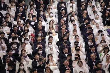 GAPYEONG-GUN, SOUTH KOREA - FEBRUARY 07: Thousands of couples attend a mass wedding held by the Fami...
