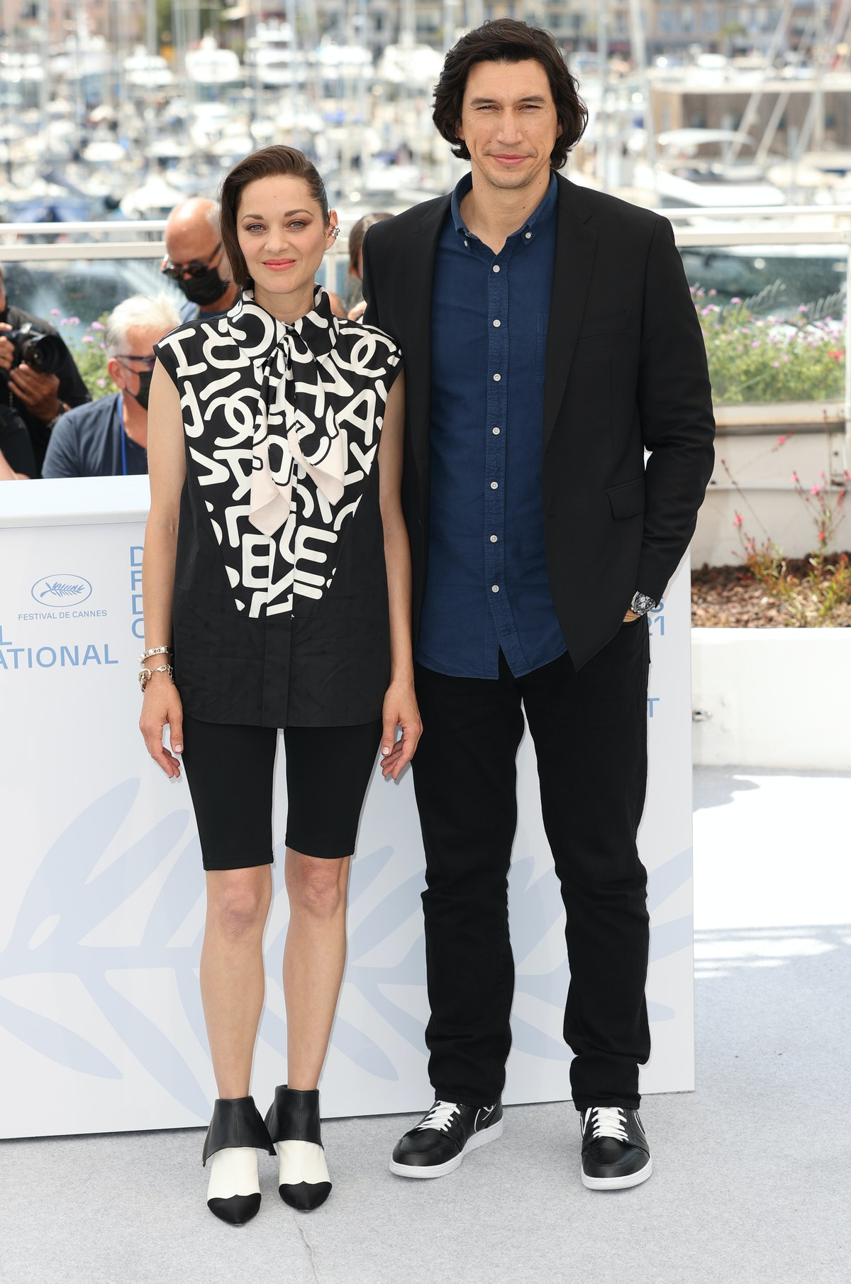 """CANNES, FRANCE - JULY 06: Marion Cotillard and Adam Driver attend the """"Annette"""" photocall during the 74th annual Cannes Film Festival on July 06, 2021 in Cannes, France. (Photo by Mike Marsland/WireImage)"""