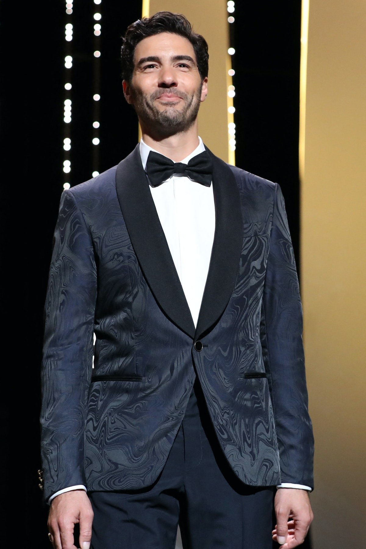 French actor and member of the Jury of the Official Selection Tahar Rahim smiles as he arrives on stage during the opening ceremony of the 74th edition of the Cannes Film Festival in Cannes, southern France, on July 6, 2021. (Photo by Valery HACHE / AFP) (Photo by VALERY HACHE/AFP via Getty Images)
