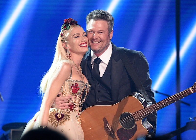LOS ANGELES, CALIFORNIA - JANUARY 26: Gwen Stefani and Blake Shelton pose onstage during the 62nd An...
