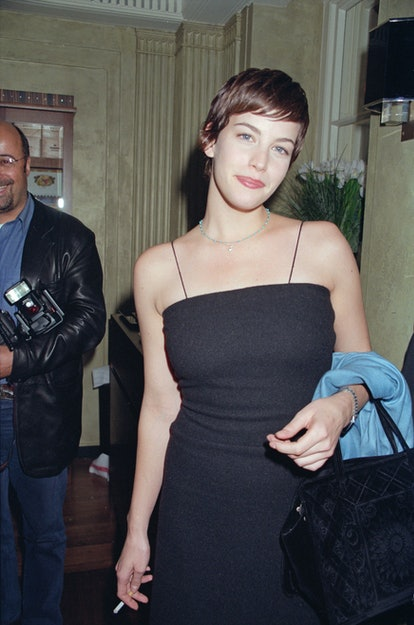 Liv Tyler wearing the side-swept bangs that came to epitomize the '90s.