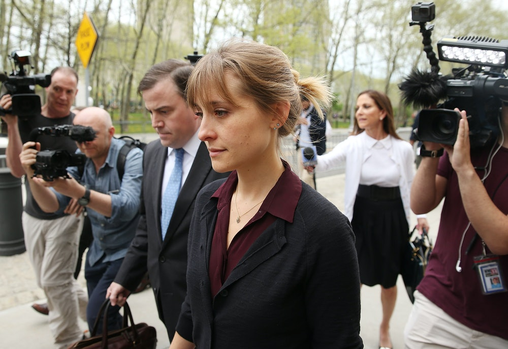 NEW YORK, NY - MAY 04:  Actress Allison Mack (C) departs the United States Eastern District Court af...