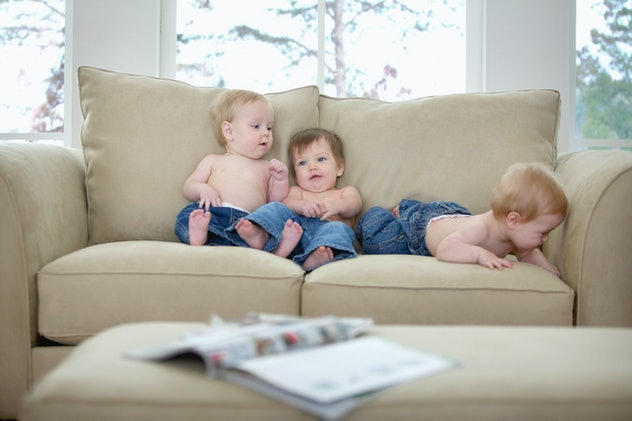 triplet babies on a couch