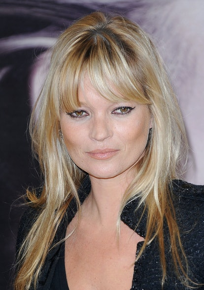 Kate Moss with lash length bangs she cut herself.