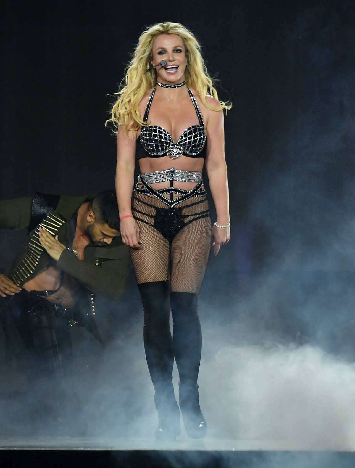 Britney Spears, shown here in a black bedazzled costume while performing in 2018 on tour, might retire from music.