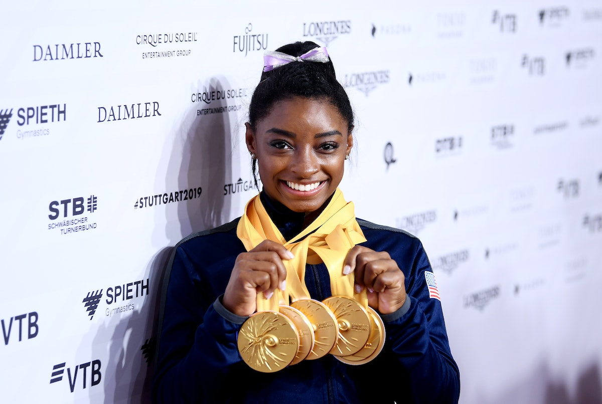 STUTTGART, GERMANY - OCTOBER 13: Simone Biles of The United States poses for photos with her multipl...