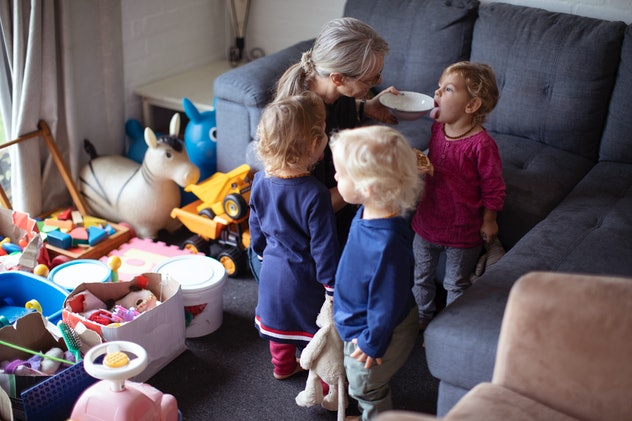 IVF triplets playing at home with their mother.