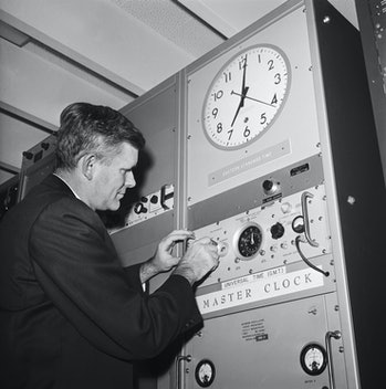 The nation's official time keepers, the National Bureau of Standards and the Naval Observatory, set their atomic clocks back a tenth of a second zero hours Universal Time, Nov. 1, 1963. Dr. R.G. Hall, Assistant Director, Times Service Division of the Naval Observatory, turns back the observatory clock.
