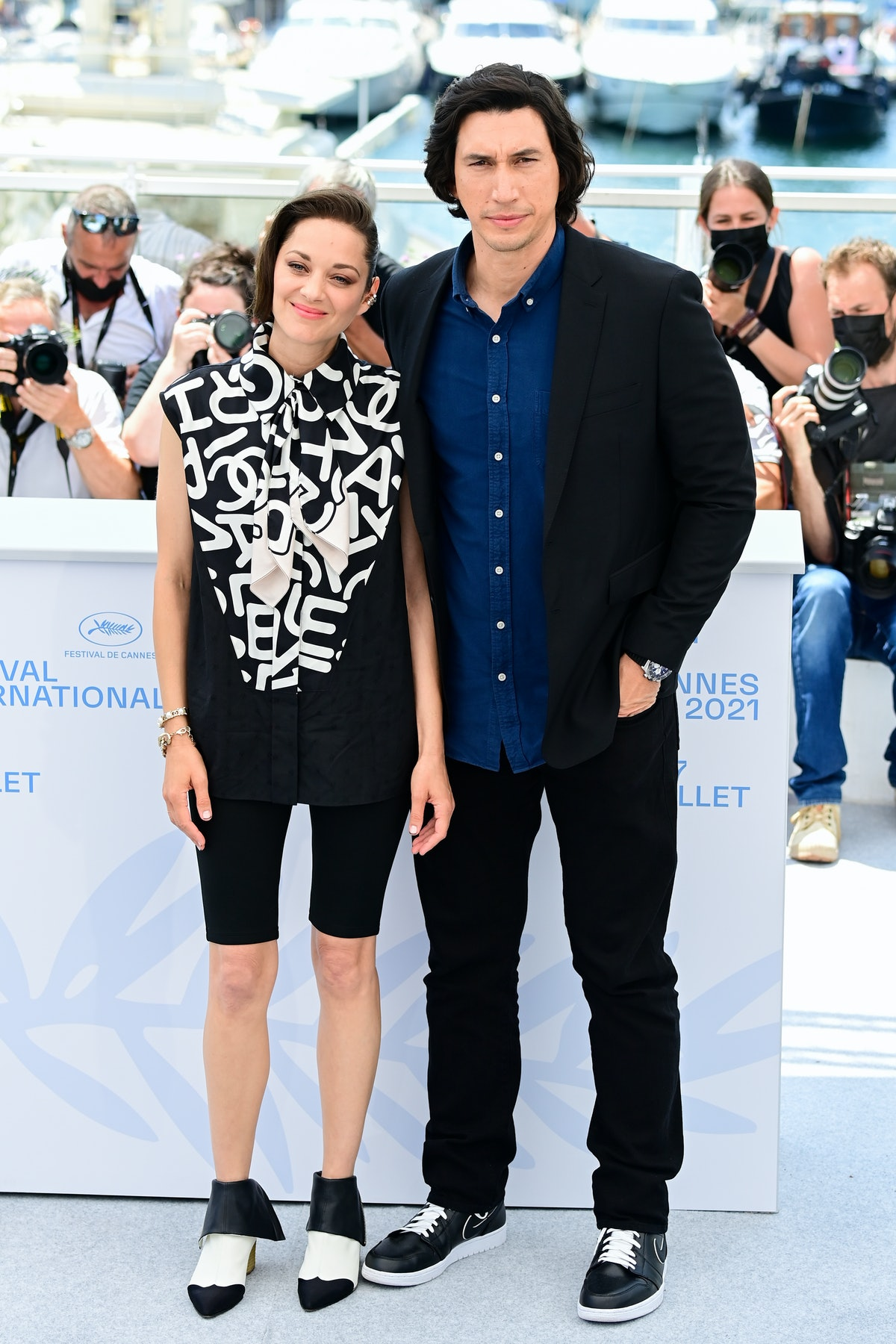 """CANNES, FRANCE - JULY 06: Marion Cotillard and Adam Driver attend the """"Annette"""" photocall during the 74th annual Cannes Film Festival on July 06, 2021 in Cannes, France. (Photo by Daniele Venturelli/WireImage)"""