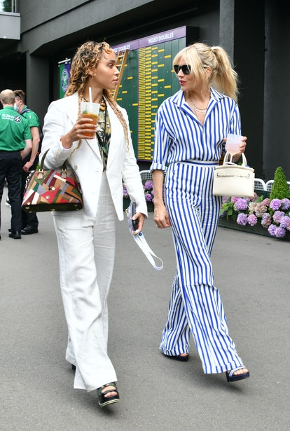 LONDON, ENGLAND - JULY 05: FKA Twigs (L) and Sienna Miller attend day 8 of Wimbledon 2021 at All Eng...