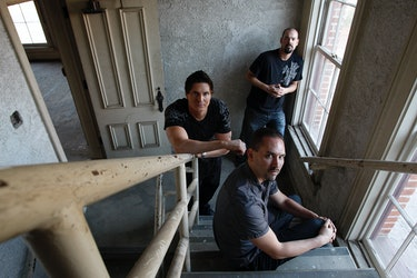Zak Bagans (left middle), Nick Groff (front), and Aaron Goodwin (back) are photographed in Pico Hous...