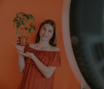 TikTok influencer holding a pot plant