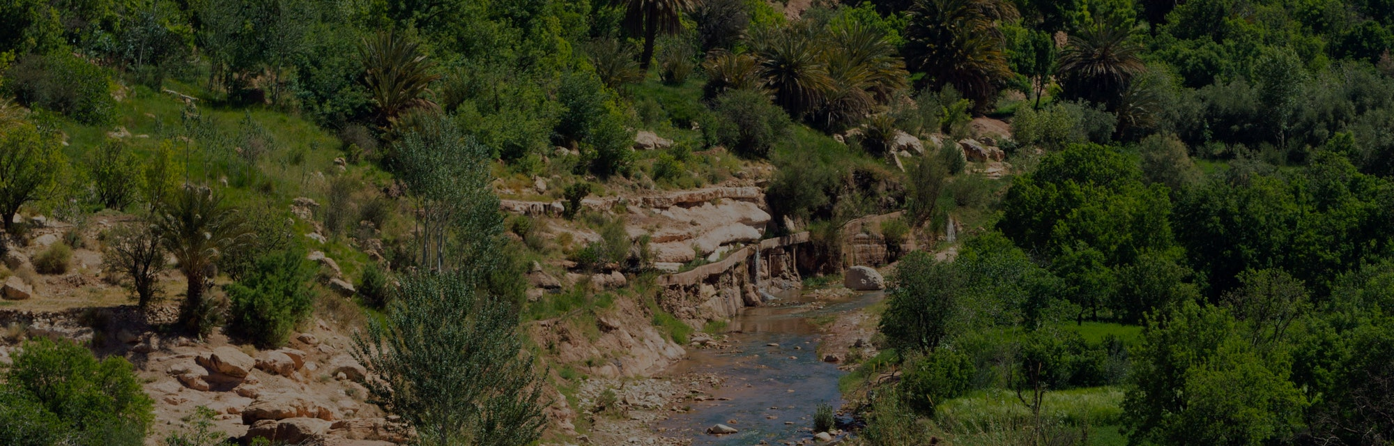 OUNILA VALLEY, MOROCCO - 23rd APRIL 2016 - The Oued (River) Ounila running through the the heart of ...