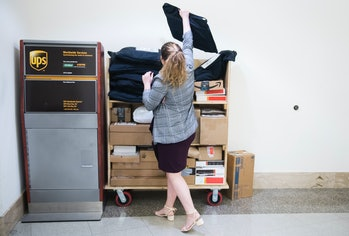 UNITED STATES - APRIL 29: An aide places a Rent the Runway bag at a UPS dropbox station outside the U.S. Post Office in Longworth Building on Monday, April 29, 2019. (Photo By Tom Williams/CQ Roll Call)