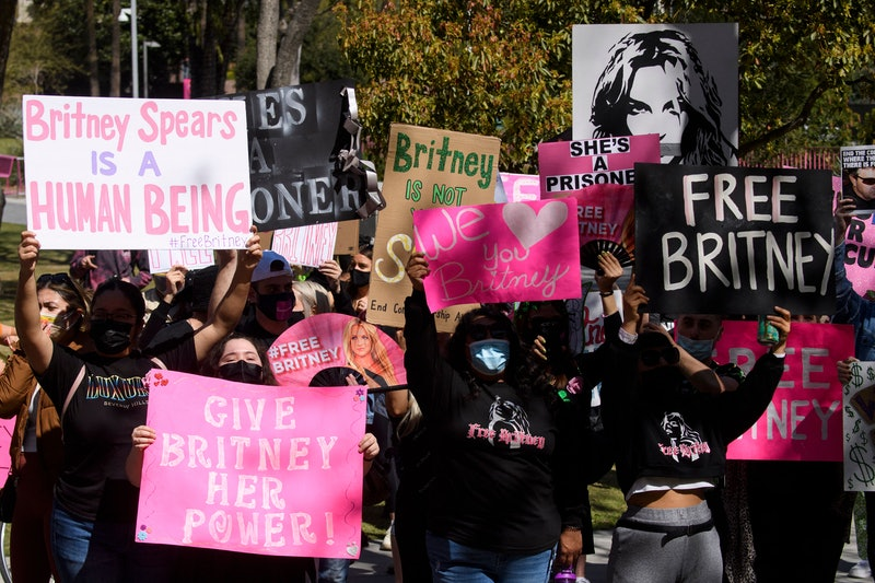 Supporters of the FreeBritney movement rally in support of musician Britney Spears following a conservatorship court hearing in Los Angeles, California on March 17, 2021. - Free Britney supporters of fans of Spears have closely followed her conservatorship case and rallied that the pop singer should be legally allowed to decide her own affairs. (Photo by Patrick T. FALLON / AFP) (Photo by PATRICK T. FALLON/AFP via Getty Images)