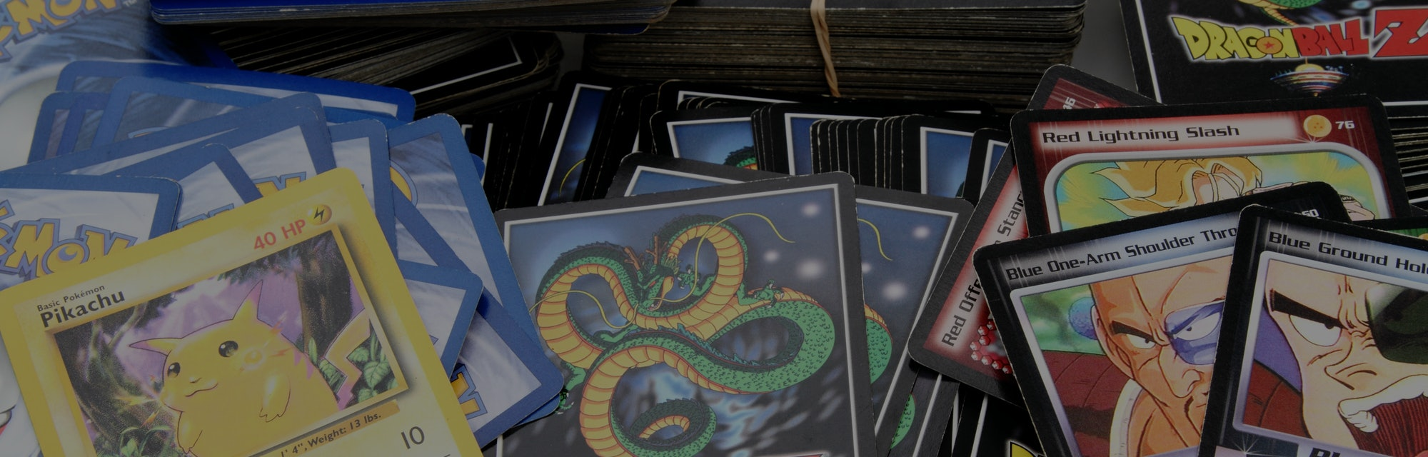 West Palm Beach, USA - April 28, 2015: Product shot of an assortment of Dragon Ball Z and Pokemon trading game cards. Pokemon trading cards are produced by Nintendo.The Dragon Ball Z cards are based on the Japanese Dragon Ball animation series created by Akira Toriyama. Dragon Ball Z cards are produced by Bird Studio/Shueisha and licensed by Funimation.