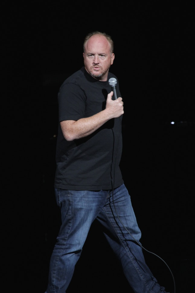 """Comedian Louis C.K. (Louis Szekely) is shown performing on stage during a """"live"""" stand up concert ap..."""