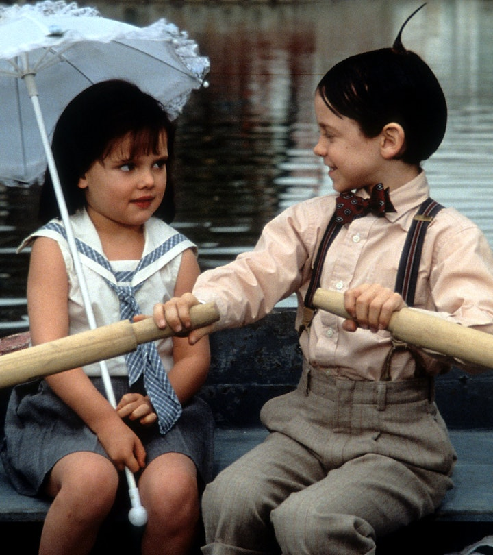 Bug Hall rowing a boat while looking at Brittany Ashton Holmes in a scene from the film 'The Little ...