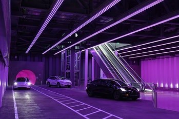 LAS VEGAS, NEVADA - APRIL 09:  Tesla cars are shown in the Central Station during a media preview of the Las Vegas Convention Center Loop on April 9, 2021 in Las Vegas, Nevada. The Las Vegas Convention Center Loop is an underground transportation system that is the first commercial project by Elon Musk's The Boring Company. The USD 52.5 million loop, which includes two one-way vehicle tunnels 40 feet beneath the ground and three passenger stations, will take convention attendees across the 200-acre convention campus for free in all-electric Tesla vehicles in under two minutes. To walk that distance can take upward of 25 minutes. The system is designed to carry 4,400 people per hour using a fleet of 62 vehicles at maximum capacity. It is scheduled to be fully operational in June when the facility plans to host its first large-scale convention since the COVID-19 shutdown. There are plans to expand the system throughout the resort corridor in the future.  (Photo by Ethan Miller/Getty Images)