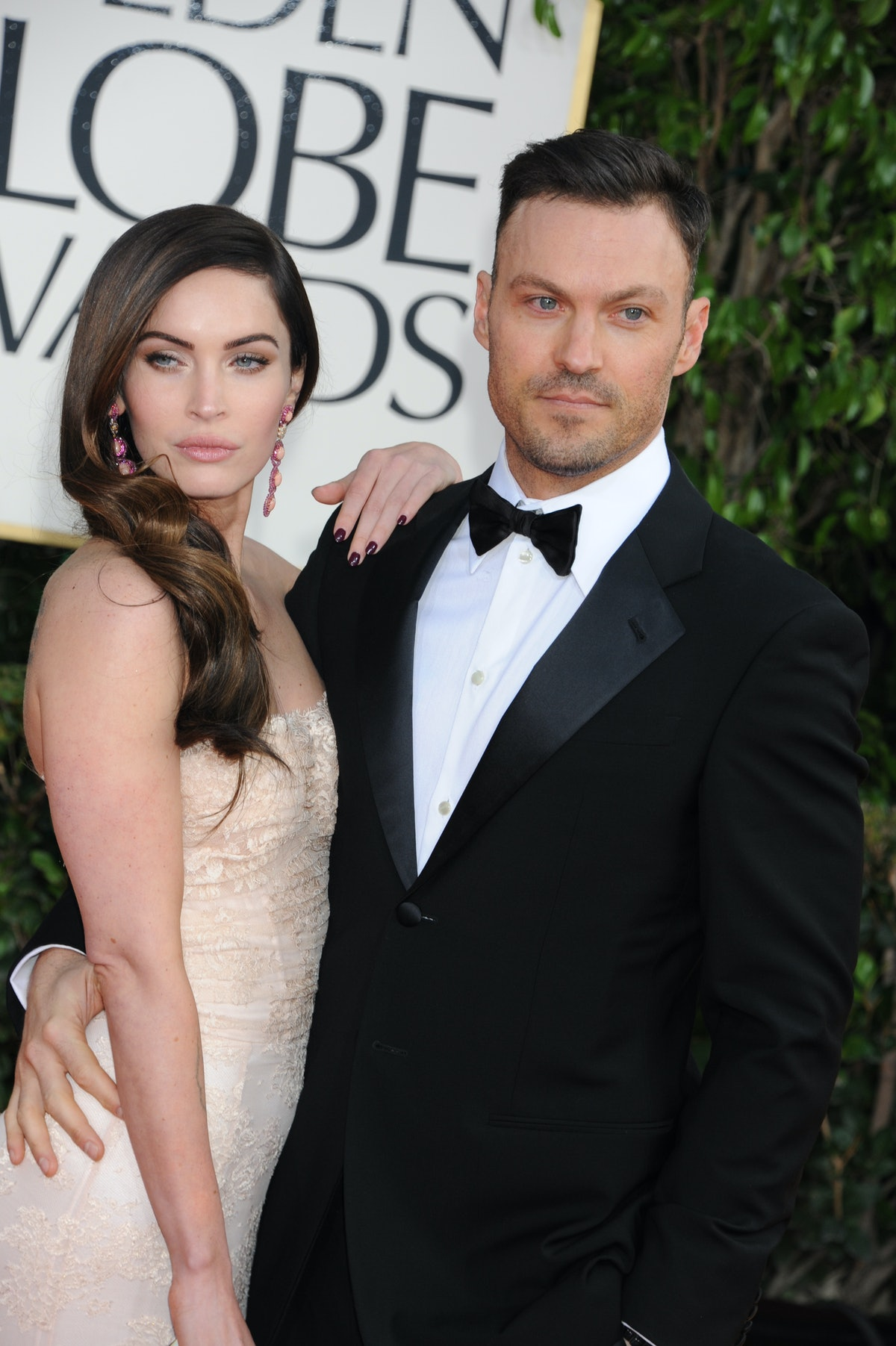 Actress Megan Fox and actor Brian Austin Green arrive at the 70th Annual Golden Globe Awards held at...