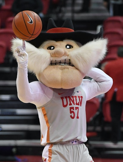LAS VEGAS, NEVADA - NOVEMBER 28:  UNLV Rebels mascot Hey Reb spins a basketball on his finger before...