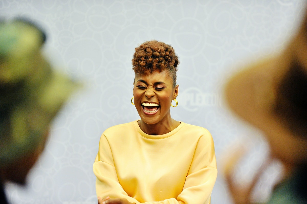 Issa Rae laughs with a brown-red frohawk haircut, a perfect look for cute, short haircut