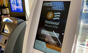 A Bitcoin ATM is seen inside a gas station in Los Angeles, California on June 24, 2021. (Photo by Ch...