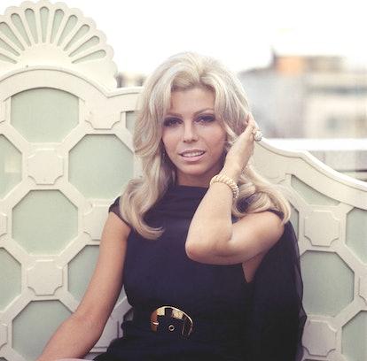 Nancy Sinatra rocking bedroom eye makeup, a style popular in the 1960s.