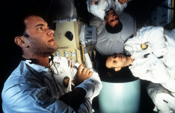Tom Hanks, Kevin Bacon, and Bill Paxton in zero gravity in a scene from the film 'Apollo 13', 1995. ...